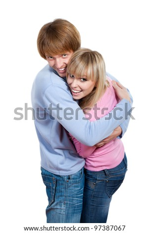 Young happy couple in love smiling, looking at camera, woman and man hug each other , isolated over white background - stock photo