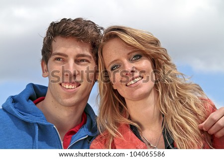 Young happy couple in the countryside