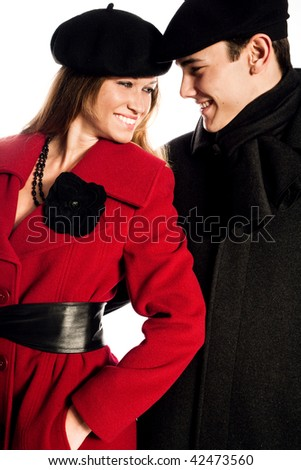 young happy couple in winter clothes, studio on white - stock photo