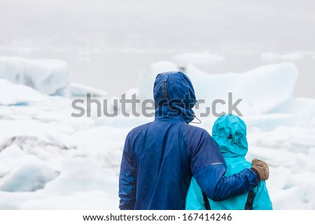 Young happy couple looking at view during hike in Iceland - stock photo