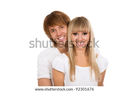 Young happy couple love smiling, wear white shirt, looking at camera, isolated over white background - stock photo