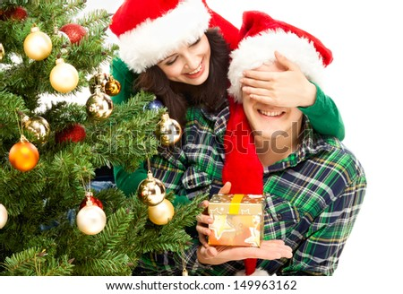 Young happy couple near a Christmas tree. - stock photo