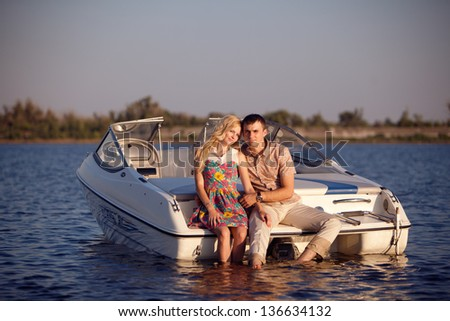 young happy couple on the boat - stock photo
