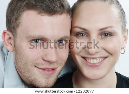 Young happy couple smiling - stock photo