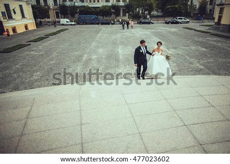 young happy couple walking on the streets