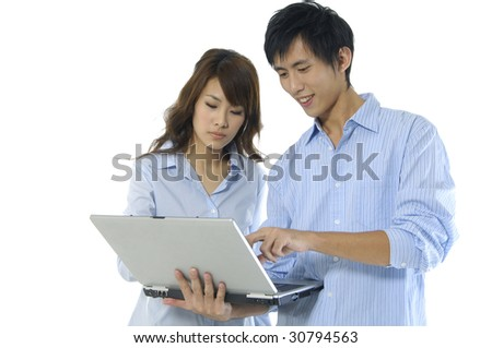 Young happy couple with computer