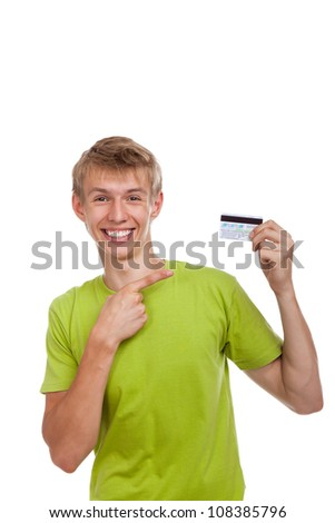 young happy excited smile man holding credit card point finger, handsome guy wear green shirt, isolated over white background - stock photo