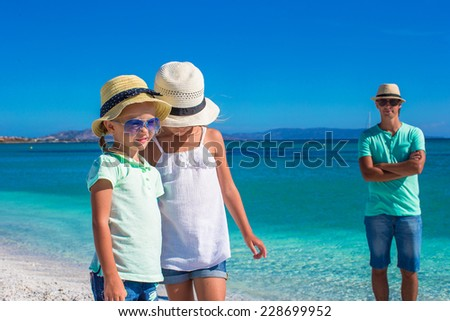 Young happy family have fun during tropical vacation - stock photo