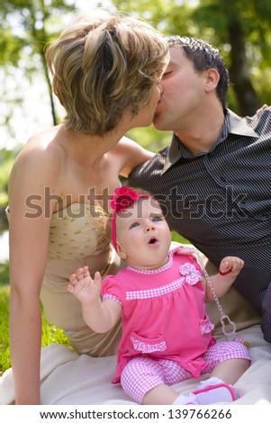 Young happy family in the park - stock photo