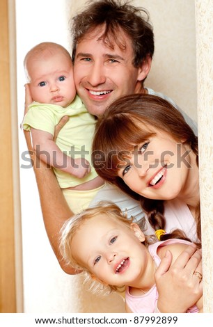Young, happy family indoors