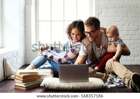 Young happy family relaxing at home