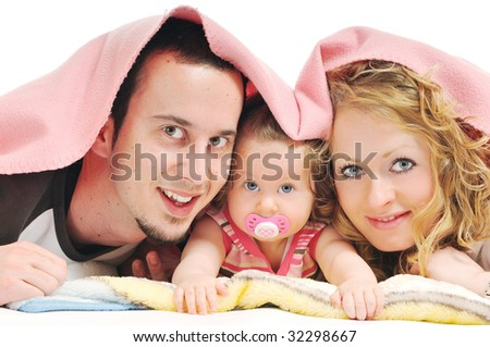 young happy family with beautiful baby playing and smile  isolated on white in studio - stock photo