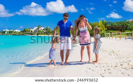 Young happy family with two kids on summer vacation - stock photo