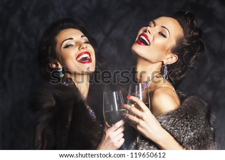 Young happy fashion women celebrating the event. Congrats! - stock photo