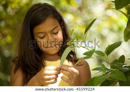 young happy female child enjoying nature - stock photo