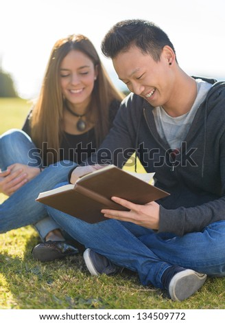 Young Happy Friends Studying In Park - stock photo