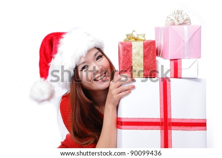 Young happy girl in Christmas hat smile holding huge christmas gift isolated on white background - stock photo