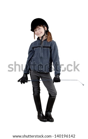 young happy girl in horse riding clothes.   little girl on a white background - stock photo