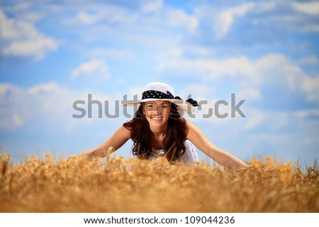 Young happy girl in wheat field