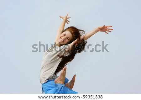 young happy girl jumping isolated - stock photo