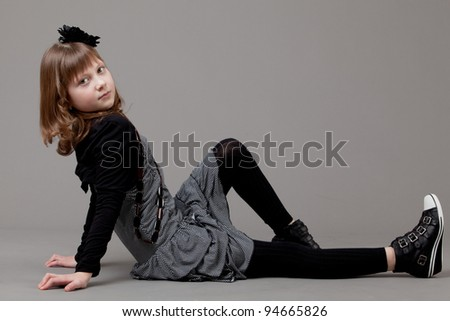 young happy girl.  little girl on a gray background. Portrait of a emotional beautiful little girl. - stock photo