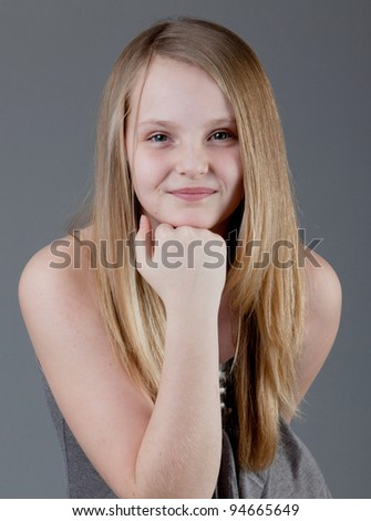 young happy girl.  little girl on a gray background. Portrait of funny lovely little girl. emotional beautiful little girl. - stock photo