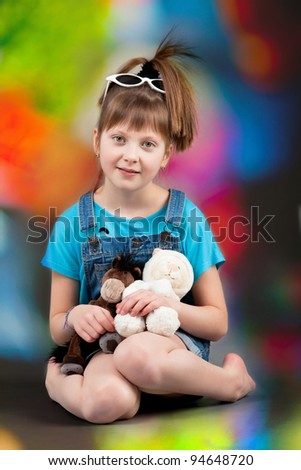 young happy girl.  little girl on colorful background. - stock photo