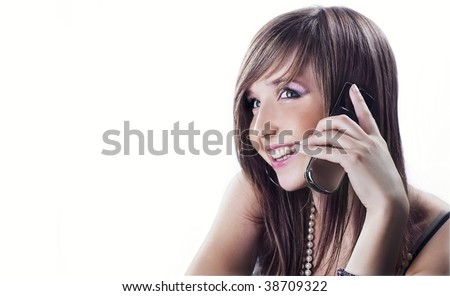 Young happy girl on phone, isolated on white