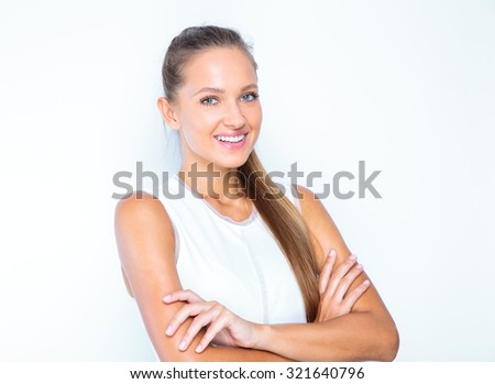young happy girl posing in studio to get a perfect portrait business shot