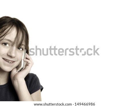 Young happy girl talking on cellphone with white background - stock photo
