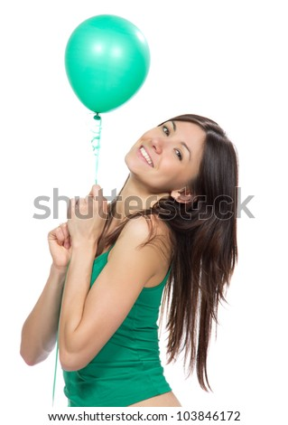 Young happy girl with green balloon as a present for birthday party smiling  on a white background - stock photo