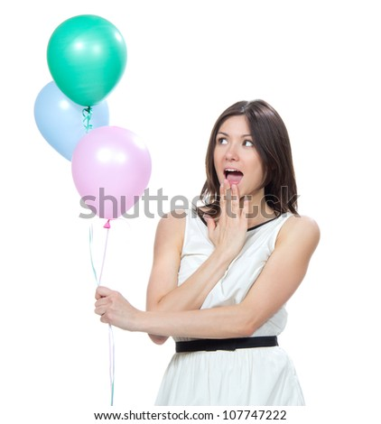 Young happy girl with pink balloons as a present for birthday party smiling and looking at the corner on a white background - stock photo