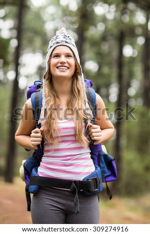 Young happy hiker looking in the distance in the nature