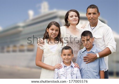 Young Happy Hispanic Family On The Dock In Front of a Cruise Ship. - stock photo