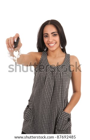 Young Happy Hispanic Female Hand over Car Key, Focus on Key, Close-up - stock photo