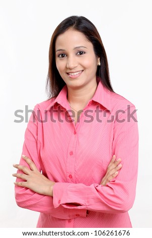Young happy Indian business woman with arms crossed