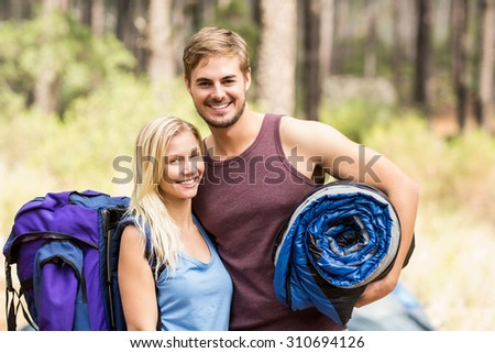 Young happy joggers looking at camera in the nature - stock photo