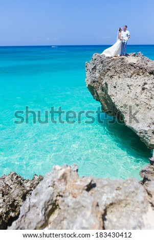 young happy loving couple on tropical background - stock photo