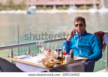 young happy man have fun on luxury boat yacht - stock photo