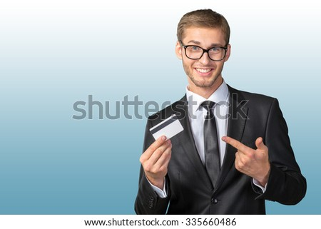 Young happy man  holding credit card