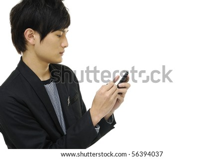 Young happy man holding mobile phone - stock photo