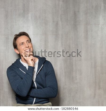 Young Happy Man In Blue Sweatshirt Thinking - stock photo