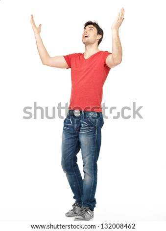 Young happy man in casuals with raised hands up isolated on white background.
