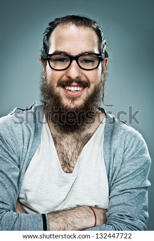 Young Happy Man Over a Grey Background