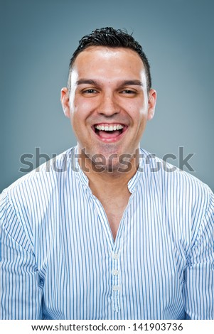 Young Happy Man Over a Grey Background - stock photo