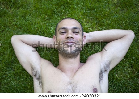 Young happy man relaxing in a park