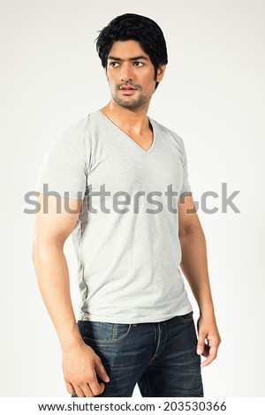 young happy man standing against grey background