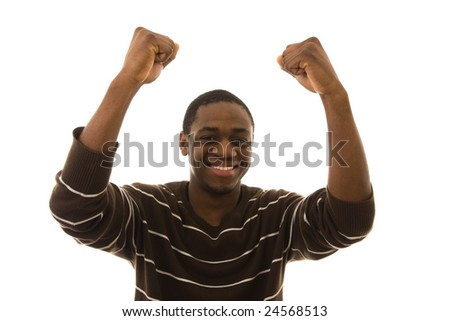 Young happy man with arms up celebrating something - stock photo