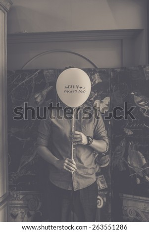 Young happy man with  Balloons a proposal - stock photo