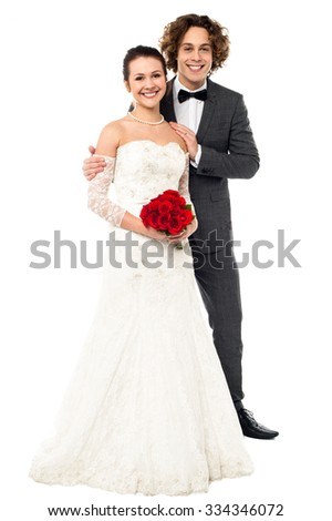 Young happy married couple isolated over white